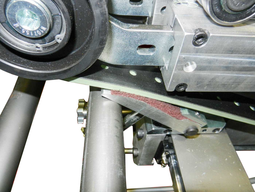 Feed Belt Cleaning System